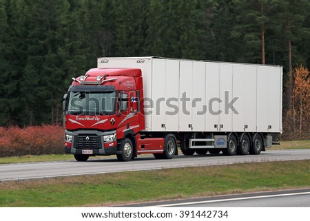 PAIMIO, FINLAND - OCTOBER 30, 2015: Red Renault Trucks T Semi moves along freeway in Paimio. Renault Trucks T is the International Truck of the Year 2015.