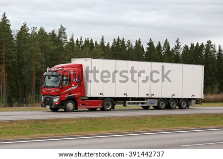 PAIMIO, FINLAND - OCTOBER 31, 2015: Red Renault Trucks T Semi moves along freeway in Paimio. Renault Trucks T is the International Truck of the Year 2015.