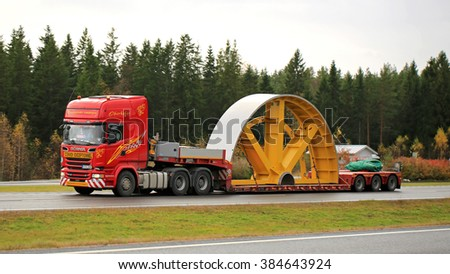 PAIMIO, FINLAND - OCTOBER 23, 2015: Scania truck hauls industrial object as exceptional load. Abnormal transport permit is needed, if any dimension of the transport exceeds the free dimension limits. - stock photo