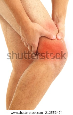 Pain concept. Young man with knee pain, isolated on white - stock photo