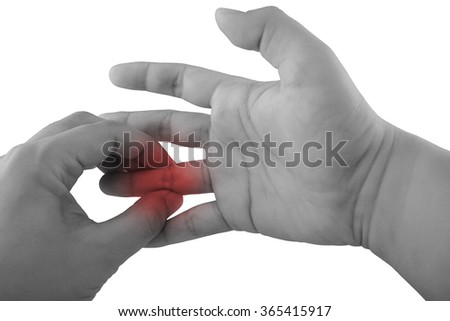 Pain in a finger. holding hand to spot of finger pain.