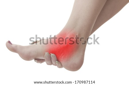 Pain in a woman ankle. Female holding hand to spot of ankle-ache. Concept photo with Color Enhanced blue skin with read spot indicating location of the pain. Isolation on a white background.