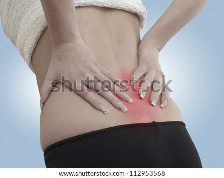 Pain in a woman back - stock photo