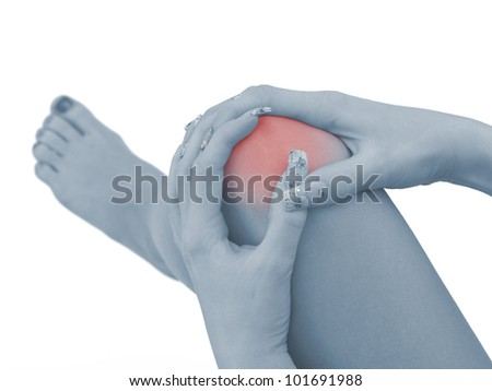 Pain in a woman knee - stock photo