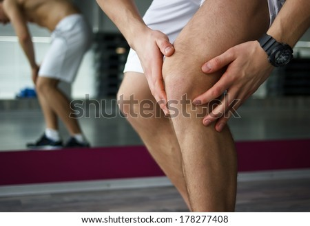 Pain in knee or another sport trauma concept - stock photo