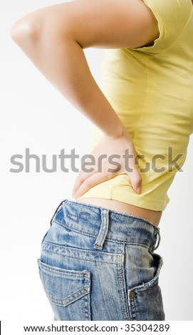 PAIN IN LOWER BACK - stock photo