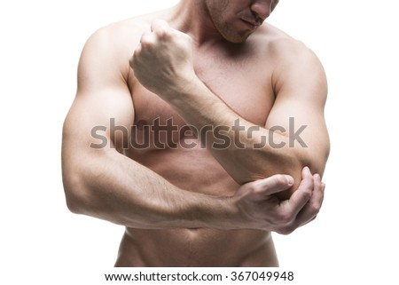 Pain in the elbow. Muscular male body. Isolated on white background. Middle part of the body - stock photo