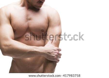 Pain in the elbow. Muscular male body. Isolated on white background with copy space. Middle part of the body - stock photo