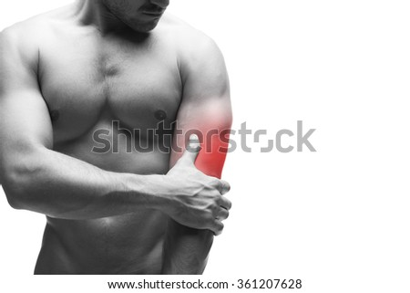 Pain in the elbow. Muscular male body with copy space. Isolated on white background with red dot. Black and white photography - stock photo