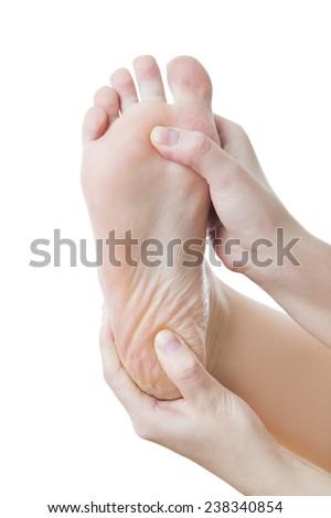 Đau ở chân.  Massage chân nữ.  Móng chân.  Bị cô lập trên nền trắng.