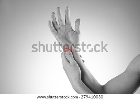 Pain in the joints of the hands. Carpal tunnel syndrome. Care of male hands. - stock photo