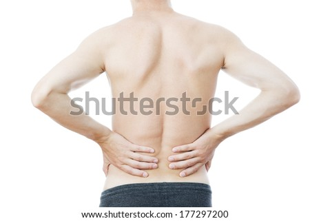 Pain in the lower back in men - stock photo