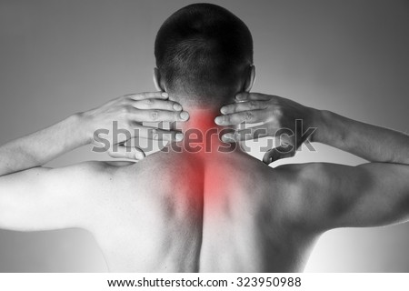 Pain in the neck. Man with backache. Pain in the man's body. Black and white photo with red dot - stock photo