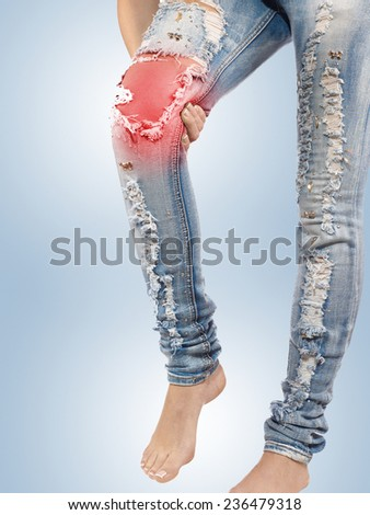 Pain in woman knee. Female holding hands on spot knee pain. - stock photo