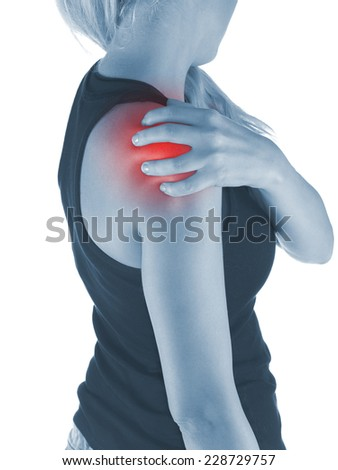 Pain in woman shoulder. Female holding hands on spot pain shoulder.