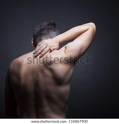 Pain neck. The back man.Black background - stock photo