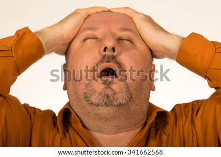 Pain. Overweight/Fat man suffering from a headache, and looking up