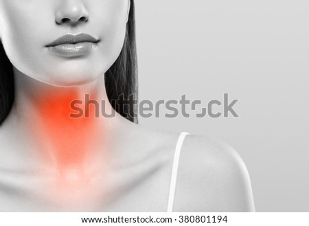 Pain throat concept. Young woman with throat pain. Black and white. - stock photo