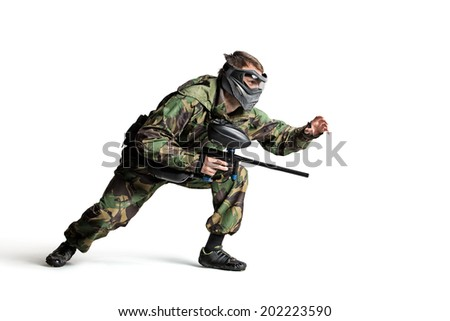 Painball player in action isolated