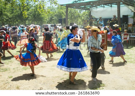 "Paine, Chile. Nov 11, 2014. Unidentified folkloric ""cueca"" dancers during traditional festival in the Chilean countryside."