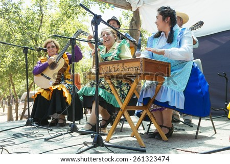 Paine, Chile. Nov 11, 2014. Unidentified folkloric musical group during traditional festival in the Chilean countryside. - stock photo