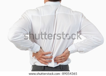 Painful back of a businessman against a white background - stock photo