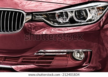 Paint and front daylight reflections on car - stock photo