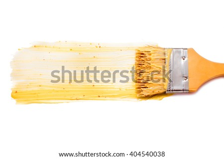 paint brush and dab of honey mustard dipping sauce. honey mustard sauce. texture. sample and brush isolated on white background. flat lay, top view - stock photo