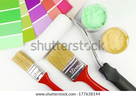 paint brush and paint color choice for interior - stock photo