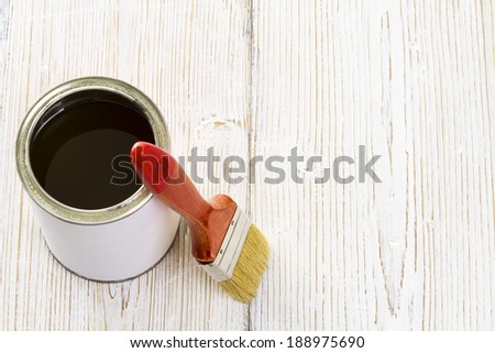 Paint brush and varnish can, paintbrush and lacquer, white color container on wooden floor background  - stock photo