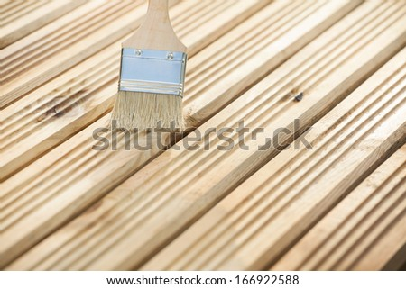 Paint brush on a wooden background  - stock photo