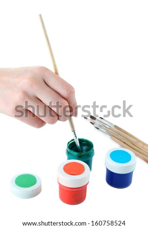Paint brushes and multicolored paints isolated on white - stock photo