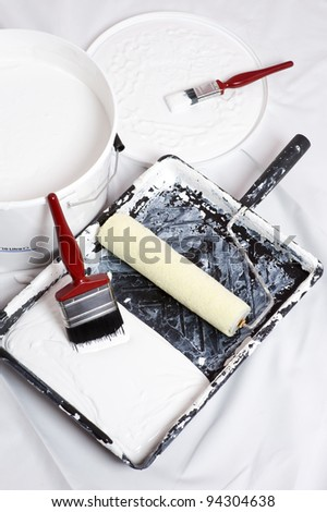 paint brushes and roller of a home decorator - stock photo