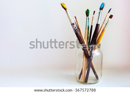 paint brushes in jar - stock photo