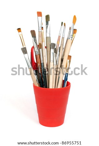 paint brushes in red glass - stock photo