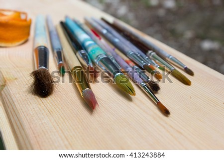Paint brushes in the sun - stock photo