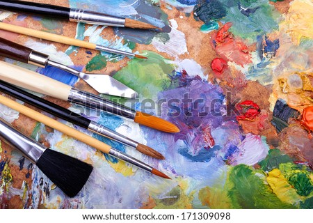paint brushes on a palette  - stock photo