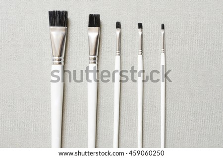 paint brushes on fabric