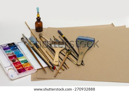 Paint brushes, paint and drawing tools. - stock photo