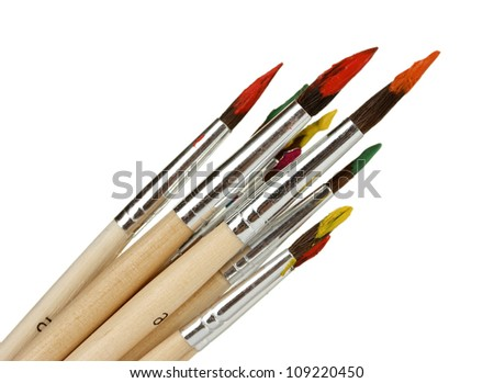 Paint brushes with gouache isolated on white - stock photo
