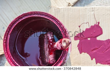 Paint cans and brush the stain on the cardboard.