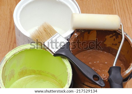 paint cans and paint tools - stock photo