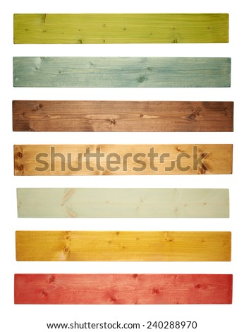 Paint coated pine wood board plank isolated over the white background, set of seven different colors - stock photo