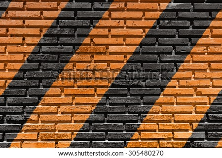 Paint color on the old brick wall texture background. - stock photo