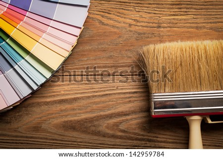 Paint colour palette and a brush in close-up. - stock photo