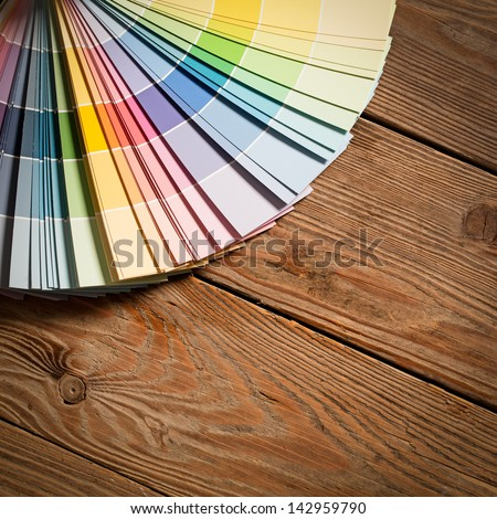 Paint colour palette on a wooden surface. - stock photo