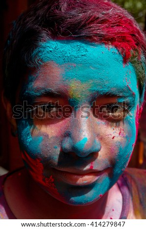 Paint covered boy for festival of Holi, New Delhi, India.