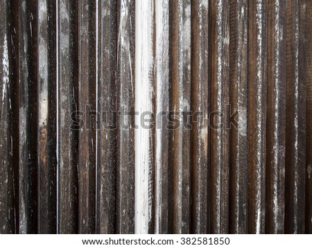 Paint fading off of old wall. - stock photo