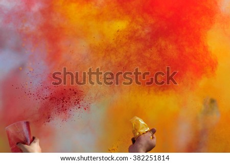 Paint in the sky during the festival of Holi - stock photo