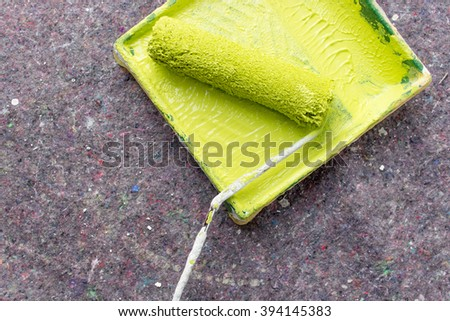 Paint roller and paint tray with light green color / painters / wall color